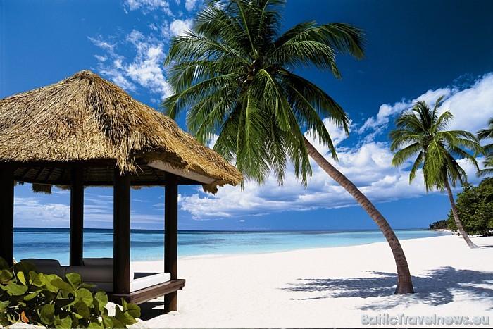 Tipiskā Karību jūras kūrorta ainava raksturīga arī Dominikānai  Foto: GoDominicanRepublic.com