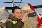 Ar somu lidsabiedsabiedrības «Finnair» lidmašīnu 5.12.2017 Rīgā ielido Ziemassvētku vecītis no Lapzemes 18