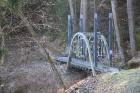 Savulaik Līgatne bijuši neskaitāmi tiltiņi, daudzi no tiem guvuši cilvēku vārdus. 19.gadsimta 80.tajos gados šo tiltiņu projektējis inženieris Eugen I 6